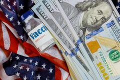Free American Vaccine Coronavirus Covid-19 Sars-Cov-2 With The US American Dollars USA Flag In The Background Royalty Free Stock Photo - 203329145