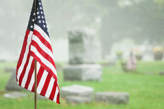 American veteran flag in foggy cemetery Royalty Free Stock Images