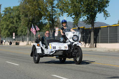 American veteranon the motocycle holding American flag Royalty Free Stock Photo