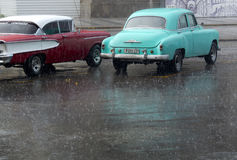 American vintage car under the rain. Royalty Free Stock Images