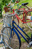 American Vintage old bicycles lined up on a bike rack. Vintage old classic american bikes bicycles parked in a bike rack in a line nostalgic Royalty Free Stock Image