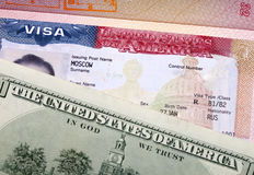 American visa on page of the  international passport and US dollars Royalty Free Stock Images