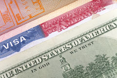 American visa on page of the international passport and US dollars, closeup Royalty Free Stock Image