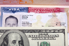 American visa on page of the Russian international passport and US dollars Stock Photos