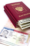 American visa on page of the Russian international passport and US dollars. The American visa on page of the Russian international passport and US dollars royalty free stock photos
