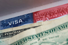 American visa in passport. With dollars currency close-up royalty free stock photos