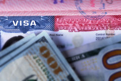 American visa in the passport and hundred-dollar bills. American visa in a passport and banknotes of one hundred dollars royalty free stock photography