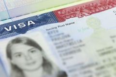 The American Visa in a passport page (USA) background Royalty Free Stock Images