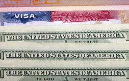 American visa and US dollars. The American visa and US dollars royalty free stock photo