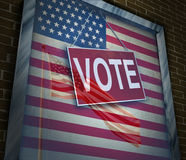 American Vote. Concept and United States elections symbol as a window with a US flag with a voting sign as an icon for presidential or government political Royalty Free Stock Images