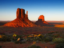American West, Iconic Buttes Attraction. Monument Valley, sandstone buttes at sunrise. American West - Iconic buttes. Utah Stock Image