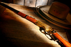 American West Legend Rifle on Cowboy Hat and Lasso Royalty Free Stock Photography