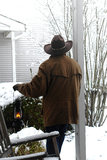 American West Legend Cowboy Contemplating New Snow Stock Image