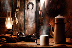 American West Legend Coffee Cup in a Cowboy Cabin Royalty Free Stock Images