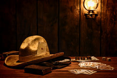 American West Cowboy Hat and Game Cards in Saloon Stock Photos