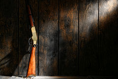 American Western Legend Old Lever Action Rifle Gun. American west legend repeating lever action rifle antique western gun and ammunition bullets on wooden floor stock images