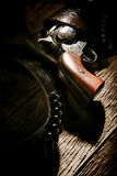 American West Legend Revolver Gun Bullet Holster. American West legend antique six-shooter revolver gun in vintage cowboy leather holster with old lead bullets Stock Image