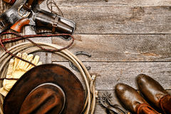 American West Legend Western Cowboy Ranching Gear. American West legend western cowboy traditional ranching gear still life with old revolver gun in leather Stock Images