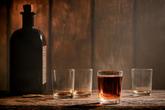 Free American West Legend Whiskey Glass On Western Bar Royalty Free Stock Photo - 36802925