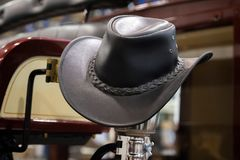 American West rodeo cowboy black leather hat in old wood ranch barn.  royalty free stock image