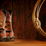 American West Rodeo Cowboy Boots and Lasso Lariat. American West rodeo cowboy traditional leather boots with roper riding spurs and authentic Western lasso stock image