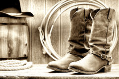 American West Rodeo Cowboy Boots at Old Ranch Barn. American West rodeo cowboy traditional leather working rancher roper boots with authentic Western riding Royalty Free Stock Photo