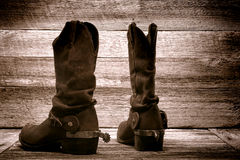 American West Rodeo Cowboy Boots in Old Wood Barn Stock Photography