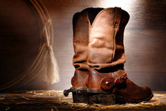 American West Rodeo Cowboy Boots and Riding Spurs. American West rodeo cowboy traditional leather roper boots rear heels with Western riding spurs and authentic stock photos