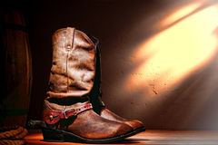 American West Rodeo Cowboy Boots and Western Spurs. American West rodeo cowboy traditional leather working roper boots with authentic Western riding spurs in a stock photos