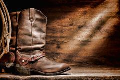 American West Rodeo Cowboy Boots and Western Spurs. American West rodeo cowboy traditional leather working roper boots with authentic Western riding spurs and Stock Image
