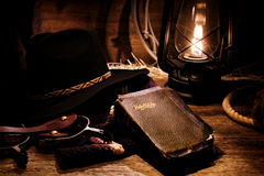 American West Rodeo Cowboy Gear and Old Holy Bible Royalty Free Stock Photo