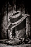 American West Rodeo Cowboy Hat atop Western Boots stock images