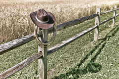 American West Rodeo Cowboy Hat and Lariat on Fence royalty free stock photos