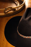 American West Rodeo Cowboy Hat and Lasso. American West Rodeo cowboy black felt hat and ranching lasso Royalty Free Stock Image