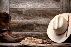 American West Rodeo Cowboy Hat on Lasso with Boots. American West rodeo traditional white straw cowboy hat with authentic Western lariat lasso and roper leather Royalty Free Stock Photo