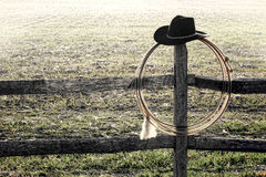 American West Rodeo Cowboy Hat and Lasso on Fence Stock Photos