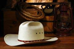 American West Rodeo Cowboy Hat and Old Ranch Tools. American West rodeo cowboy white straw hat with traditional ranch equipment and old ranching tools in a stock images