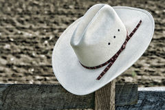 American West Rodeo Cowboy Hat on Ranch Fence Post Stock Image