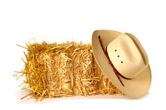 American West Rodeo Cowboy Hat and Straw Bale Stock Image