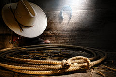 American West Rodeo Cowboy Lariat Lasso in Barn. American West authentic rodeo cowboy lariat lasso hondo or honda noose with end loop rawhide speed burner on royalty free stock image