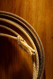 American West Rodeo Cowboy Lariat Lasso on Wood Stock Photography