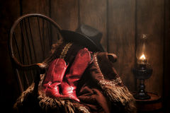 American West Rodeo Cowgirl Boots and Western Coat Stock Images