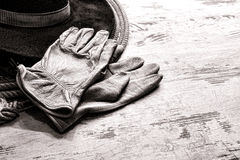 American West Rodeo Ranching Gloves on Western Hat Royalty Free Stock Photography