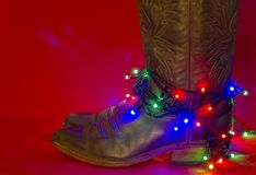 American West traditional boots on christmas red background for stock photos