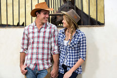 American western couple. Loving american western couple holding hands in stable Royalty Free Stock Photo