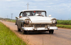 American white classic car in cuba. On the road Royalty Free Stock Image