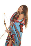 American woma bow blanket looking. An American Indian woman in her traditional blanket holding on to her bow and arrow Royalty Free Stock Images