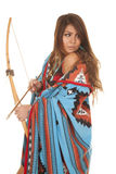 American woman bow blanket look back. An American Indian woman in her traditional blanket holding on to her bow and arrow Stock Photos