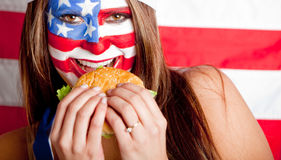 American woman eating hamburger Royalty Free Stock Image