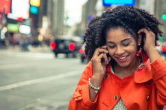 American woman making a phone call in Time Square Stock Images